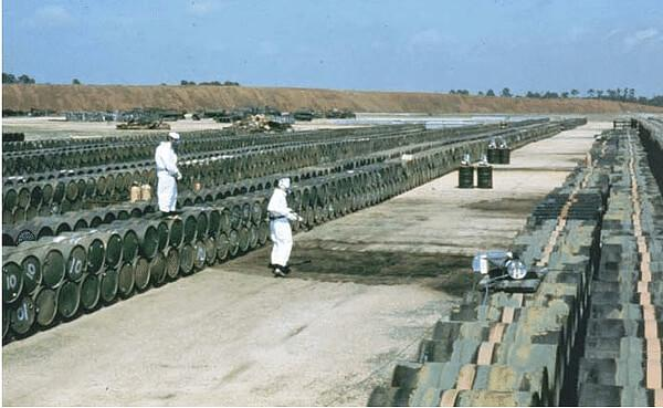Barrels of Agent Orange stored at NCBC in Gulfport, 1975. (USAF).